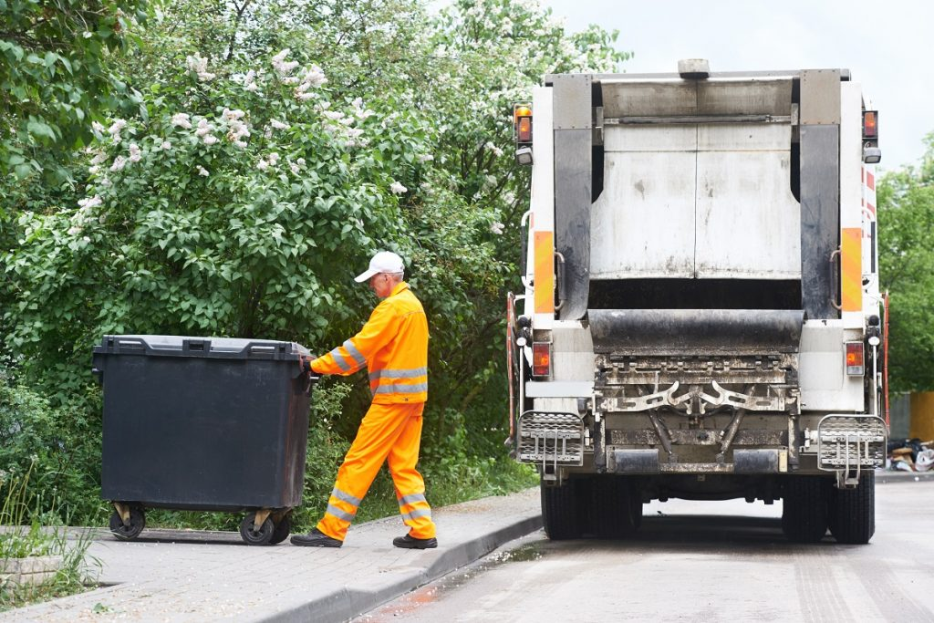 Garbage collector loading a truck